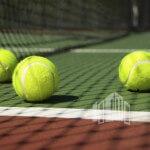 Bright greenish, yellow tennis ball on freshly painted cement court